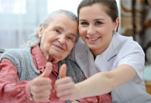 elderly woman and a female caregiver