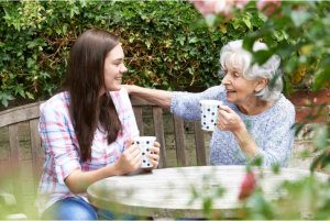 elderly woman talking to a young woman